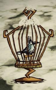 Śnieżny_ptak_w_klatce_na_ptaki